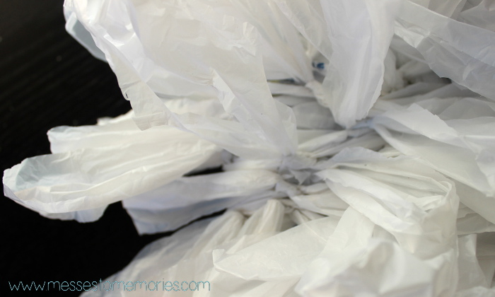 tying the plastic bags